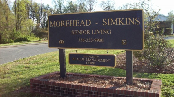 Senior Living Sign with Hanging Rider
